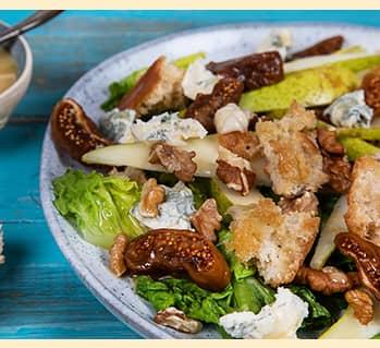 A photo of a Gorgonzola, Fig & Pear Salad